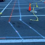 marking parking lot for cutting and install of new pipping