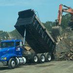 dump truck unloading debris