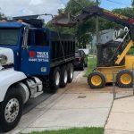 truck services bobcat loading dump truck